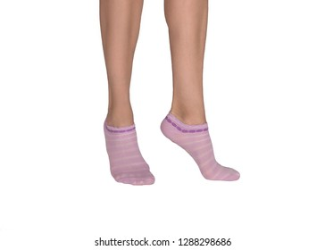 Female feet in color short socks, woman stands on tiptoe. Tanned skin, close up, isolated on white. Beauty, fashion and trendy hosiery concept