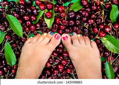 Female feet in fresh summer berries
