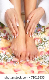 Female feet massage and flowers