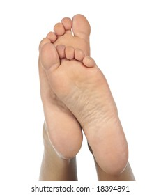 Female feet on a white background