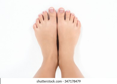 female feet on a white background