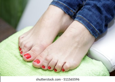 female feet with red nail Polish, close-up