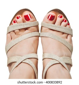 Female feet in sandals. The view from the top.