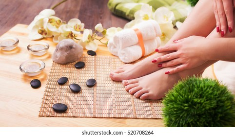 Female feet at spa pedicure procedure