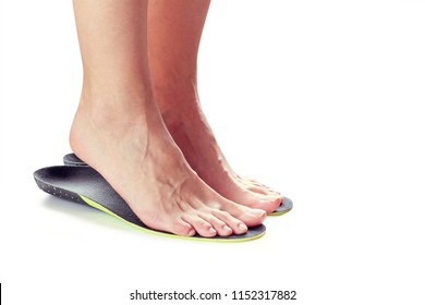 female feet stand on their toes in orthopedic insoles