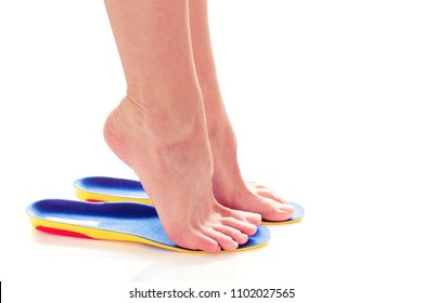 female feet stand on tiptoe in orthopedic insoles