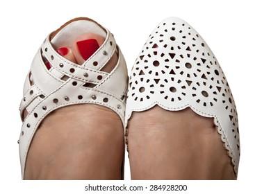 Female feet in summer shoes white