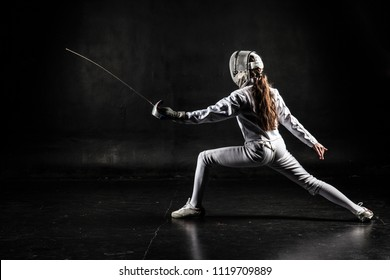 Female fencer isolated on black background