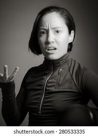Female fencer wearing fencing uniform gesturing with shrugging
