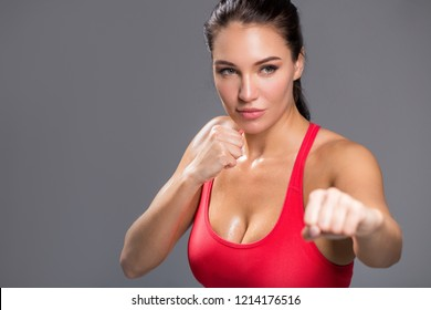 female fighter is going to attack. woman attending boxing classes. close up photo. copy space. strength and agression concept. copy space