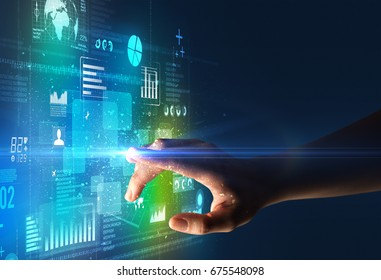 Female finger touching a beam of light surrounded by blue and green data and charts