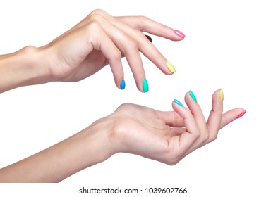 Female fingers with fancy bright green, yellow, pink and blue nails manicure. Girl's hands isolated on white background