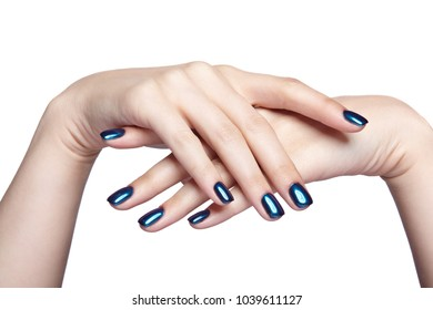 Female fingers with shiny blue nails manicure. Girl's hands isolated on white background