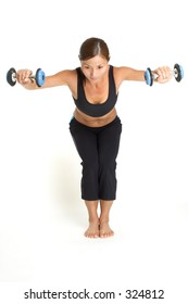 A female fitness instructor demonstrates the finishing position of the dumbbell bent over raise