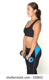 A female fitness instructor demonstrates the starting position of the straight arm dumbbell raise