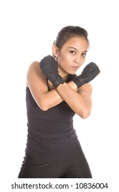 Female fitness instructress in defense stance, both fist held close to upper body, isolated.