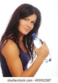 Female fitness model holding a water bottle