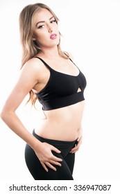 Female fitness model posing in studio. Cinematic Portrait Style.