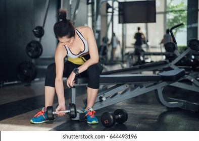 Female fitness person lifting weight in the gym