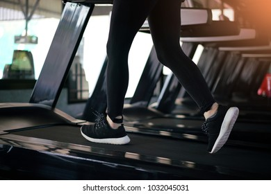 Female fitness run on treadmill