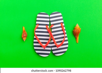 Female flip flops on a colorful vibrant background