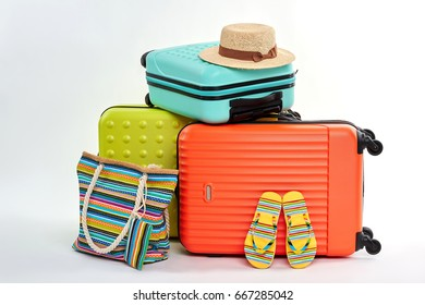 Female flips and handbag, suitcases. Accessories for beach resort.