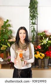 Female florist in flower shop or nursery