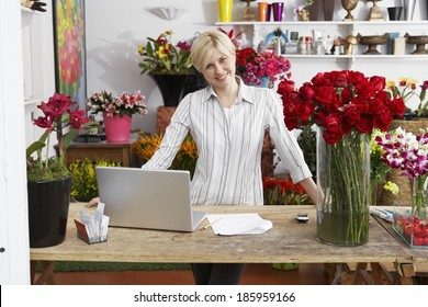 Female florist with laptop (portrait)