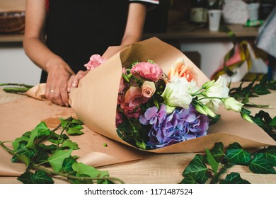 Female florist making flower bouquet