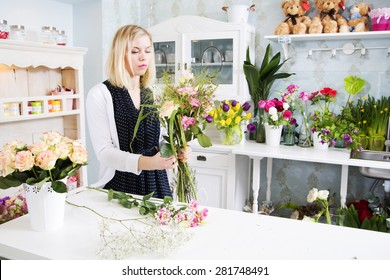 Female florist on busy day at work