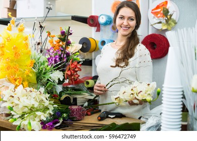female florist purchasing in flower section at store
