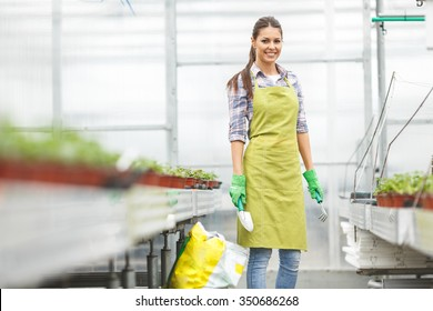 Female florist working in her greenhouse