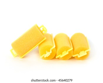 female foam rubber's hair curlers isolated on white background