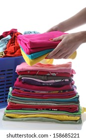 Female folding children's clothes on isolated background