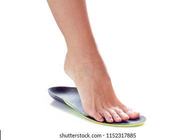female foot stands on their toe in orthopedic insole