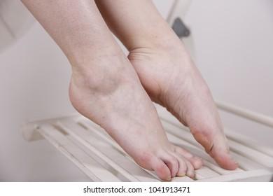 female foot steps; female legs; pedicure of feet