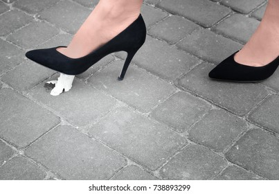 Female foot stuck into chewing gum on street. Concept of stickiness