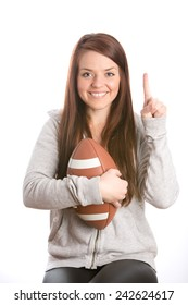 Female Football Fan - This is an image of a cute female football fan who is happy that her team just won the game. Shot on an isolated white background.