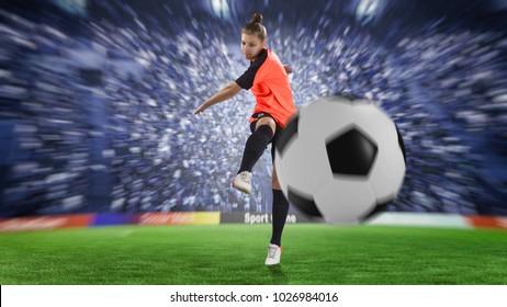 female football player in orange uniform kicking the ball