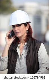 Female foreman using radio to communicate