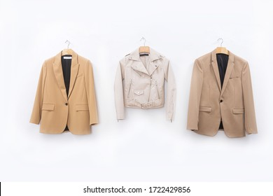female, formal business brown suit, jacket closeup  on hanging isolated on white background