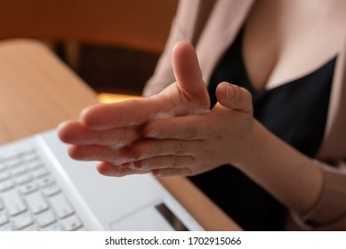 Female Freelancer Rubs Her Hands With Hand Sanitizers.