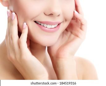 female with fresh clear skin, white background