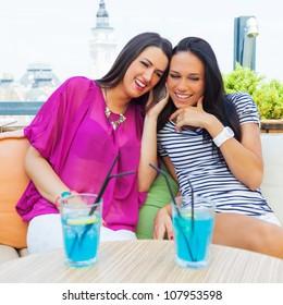 Female friends in cafe.
