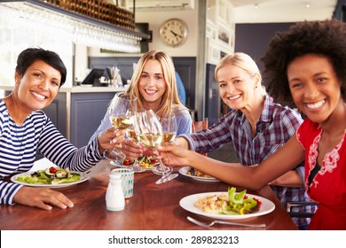 Female friends eating at a restaurant, portrait