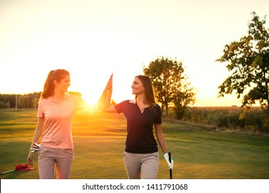 Female friends enjoying sunny day on the golf course