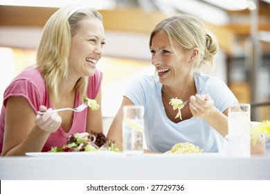 Female Friends Having Lunch Together At The Mall
