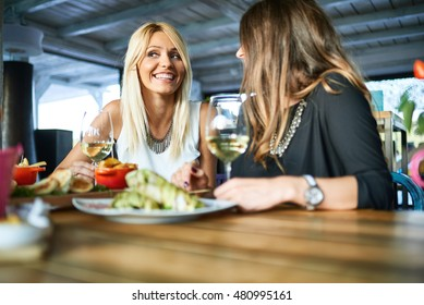 Female Friends Having Lunch Together At The Mall / Restaurant