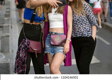 Female friends making selfie with smart phone, hanging out in the city, fashion outfits