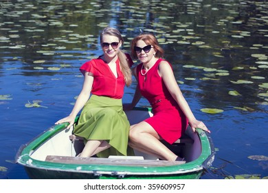 Female friends sailing in the small boat